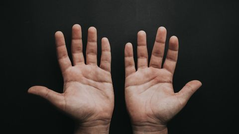 Brain Imaging During Tactile Stimulation Can Tell Left- and Right-Handers Apart